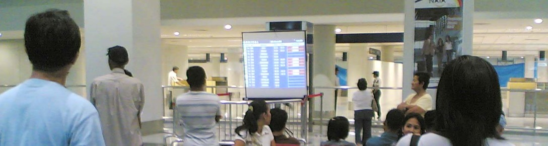 A projector screen for the flight status monitor at NAIA 3's arrival lounge? Talk about state-of-the-art and world class in the Philippines!