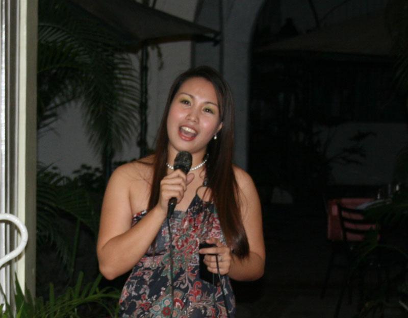 Ms. Wonder Rufino serenading the guests