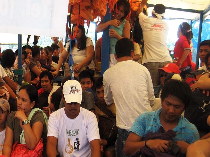 Packed like sardines. Port authorities don't even see to it if life vests are used or not