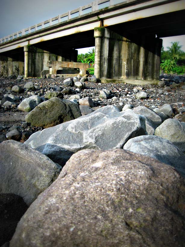 Mayon's debris litter the dry riverbed of Buang