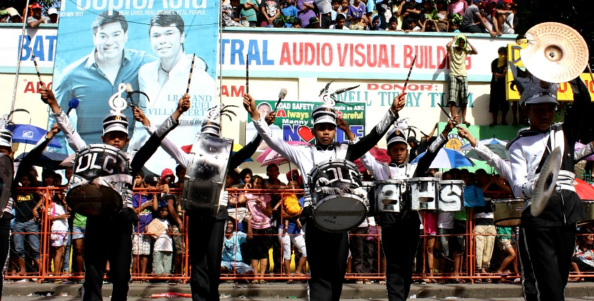 I took about a hundred shots of the marching band competition at the fiesta in Bato, Camarines Sur, and not a picture is without a grinning politician's poster in the background. Election is nigh friends. The national circus is back in town.