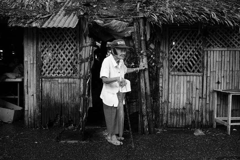 Old lady and nipa hut Bacolod City
