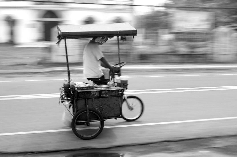 Fishball vendor rolling fast on Iriga-Baao Road, Iriga City.