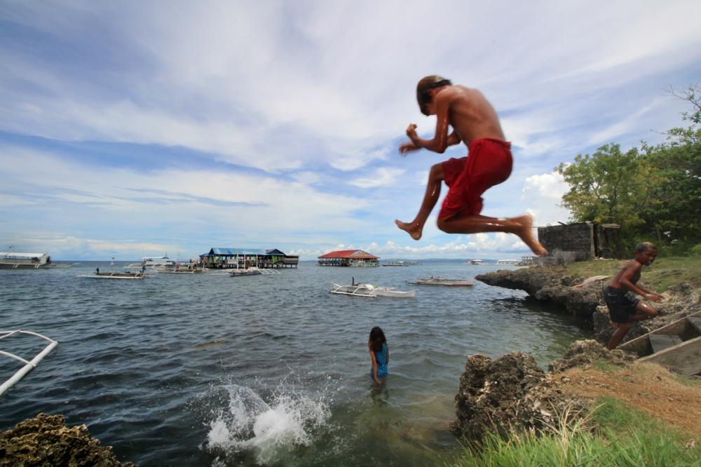 A boy takes a plunge in Caw-oy beach, Olango Island