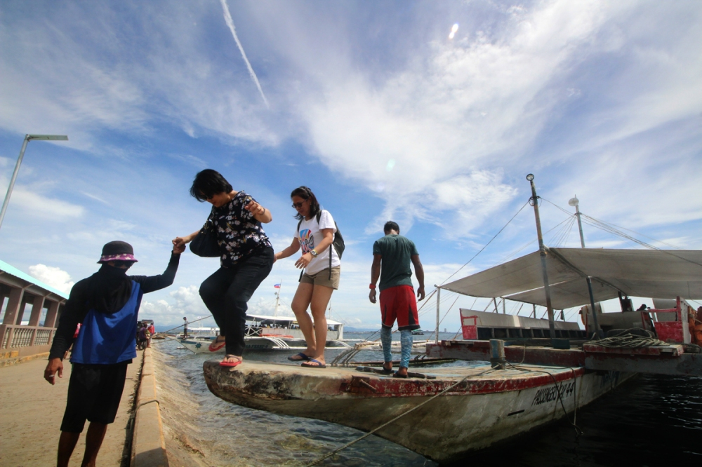 Disembarking from a boat in Santa Rosa Port, Olango Island