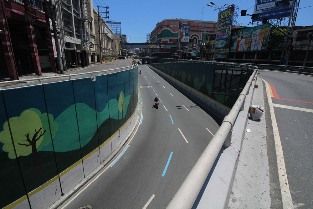 Motorcycle rider passing through underpass