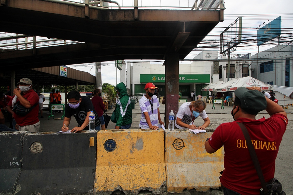 People filling up forms on the street