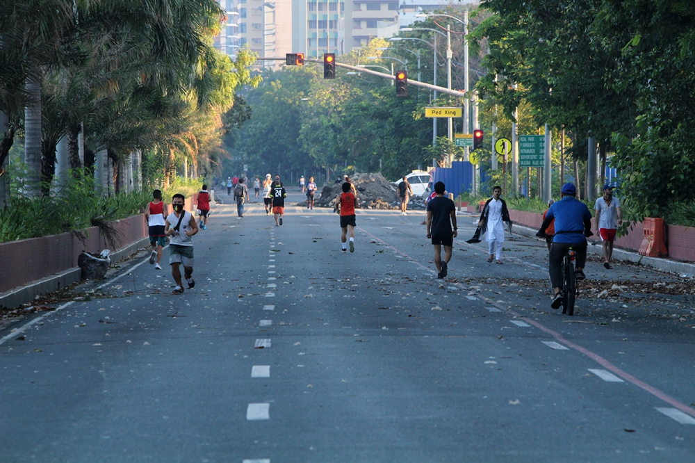 Roxas Boulevard filled with people jogging and walking